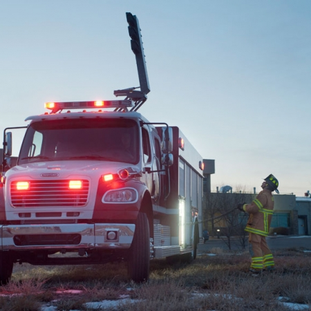 Command Light, CL Series, LED Light Tower, Fire Truck Lights, Fireman opperating Command Light on firetruck